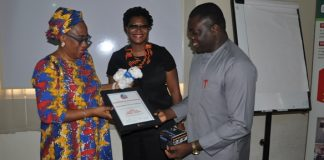Kwara State DG of Hospital Management Bureau, Dr Bunmi Jetaro Winters, presenting the award to Executive Director of OHAI, Dr. Ver-or Ngutor on behalf of Smile Train while Programme Director Smile Train, West/Central Africa, Mrs. Nkeiruka Obi looks on.