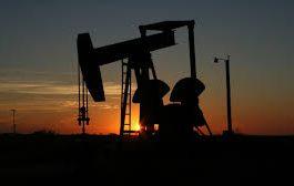 Oil slips on economic slowdown, as OPEC-led cuts still support